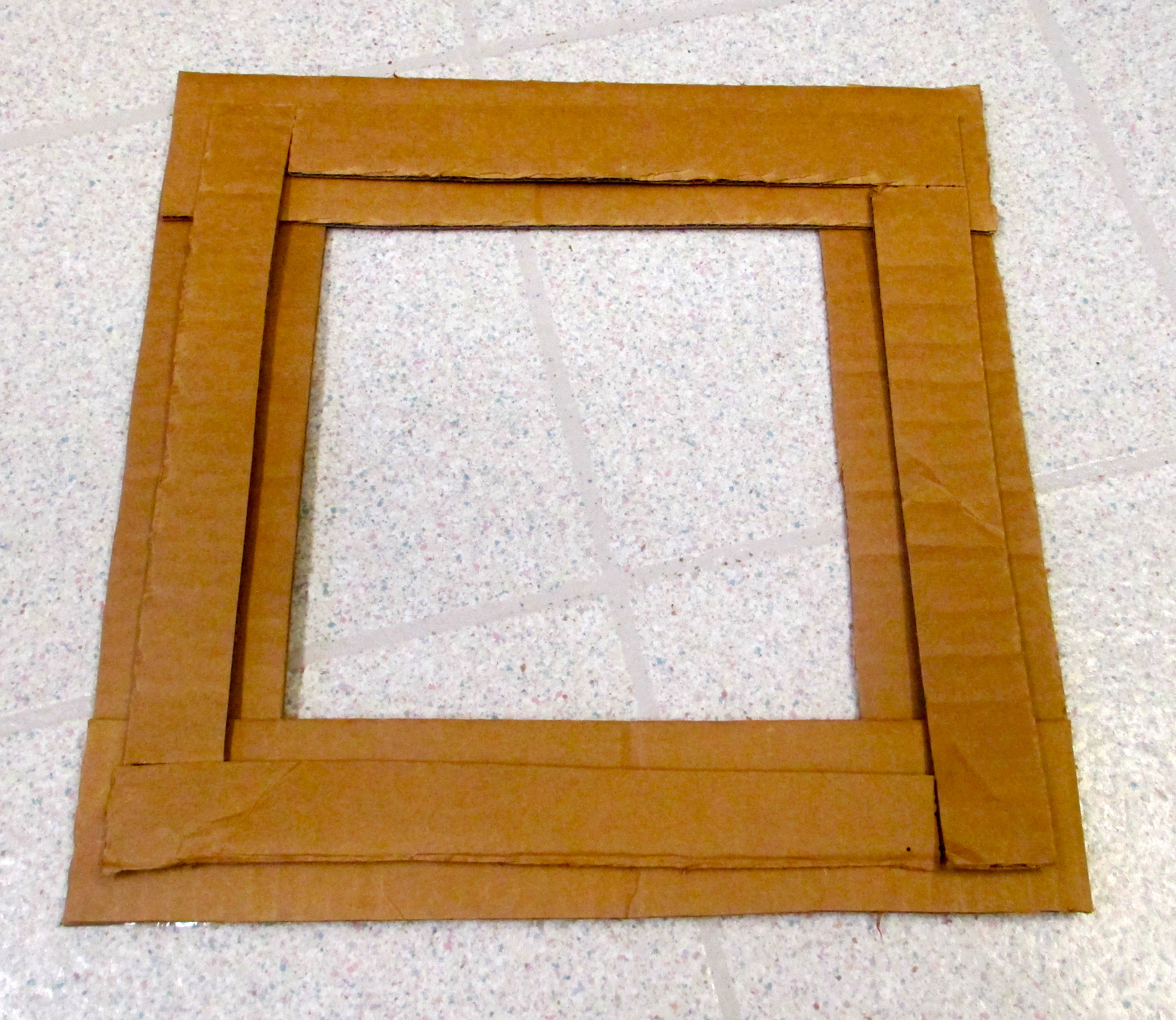 Picture of Use Double-sided Tape to Layer New Flaps Atop Frame Foundation.