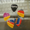 make your own guitar picks from gift or credit cards!