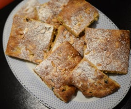 Sweet Focaccia With Raisin, Saffron, and Pine Seeds.