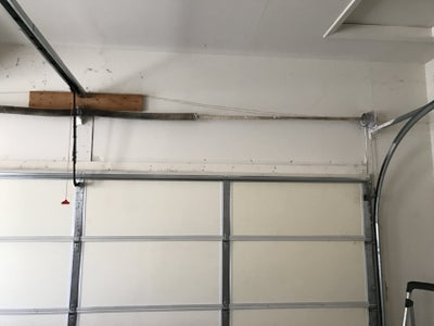 Add a Spur Gear to the Inside of the Spring Bar on the Garage Door.