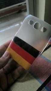 2.for the Mobile Case,hold the Case in One Hand and Start Taping It According to Flag Color.