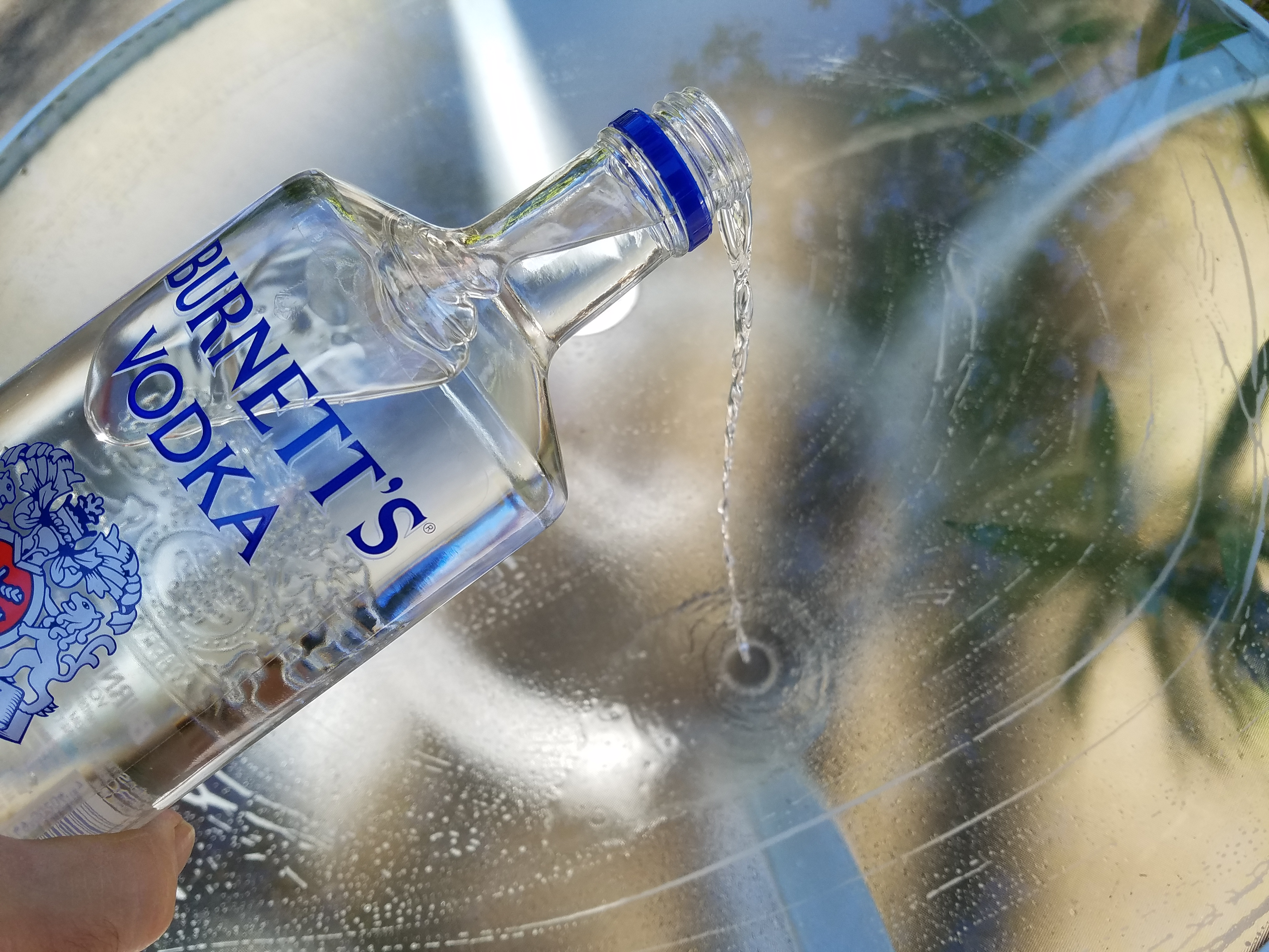 Picture of Vodka Also Works Great on Glass Patio Tables in the Backyard, Etc..