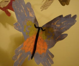 "How to make a ""parent and me"" handprint butterfly mobile from newspaper"