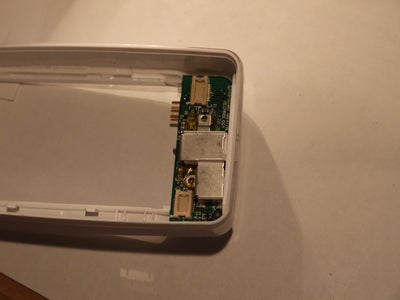 Place the Paper, and Resecure the Metal Casing
