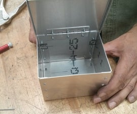 A Riveted Metal Box With Lid