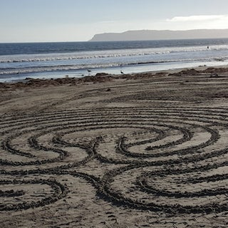 Drawing the Nine-circuit Transition Labyrinth in the Sand.