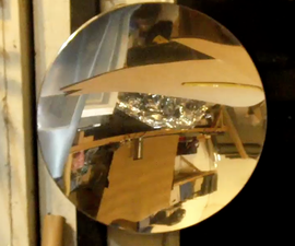 DIY PARABOLIC MIRROR from a trash can lid.