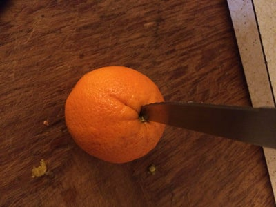 ​Make a Hole in the Middle of the Orange.