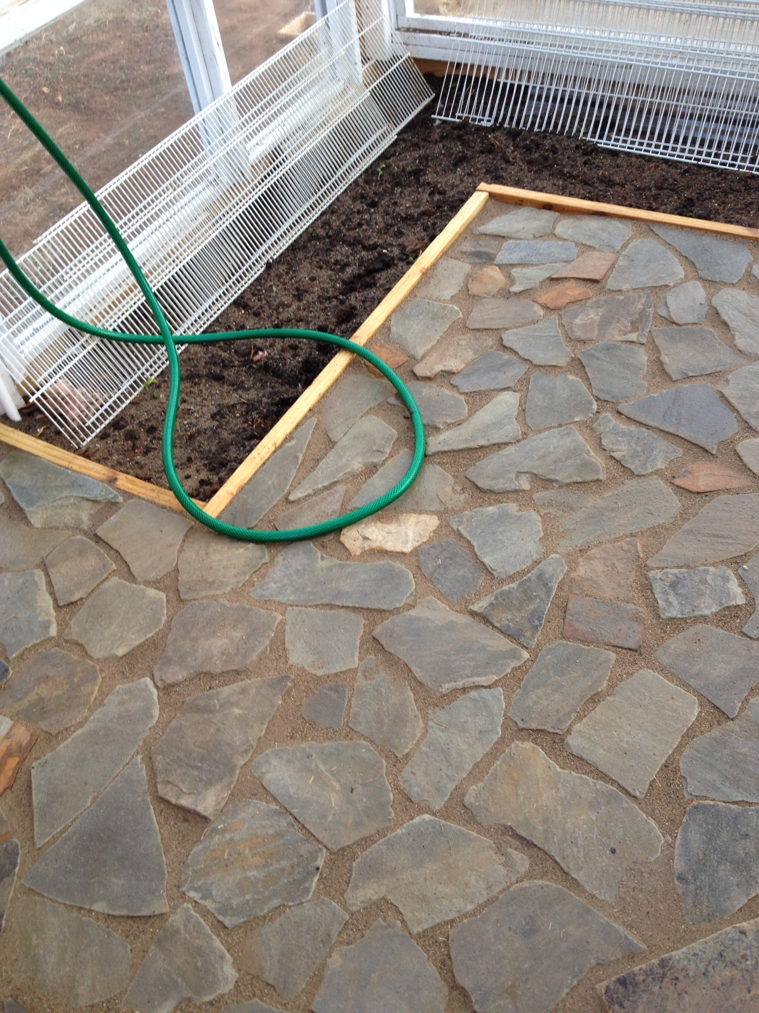Picture of Flagstone Floor Installation - Heat Storage Device.