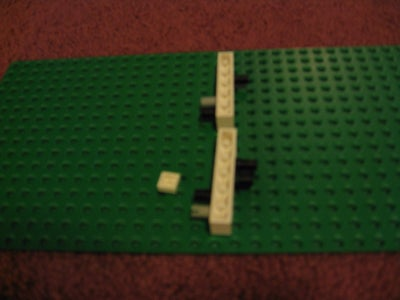 Get Two 1x6 Bricks With Holes in Them and Place 7 Technic Connectors in the Holes Shown.