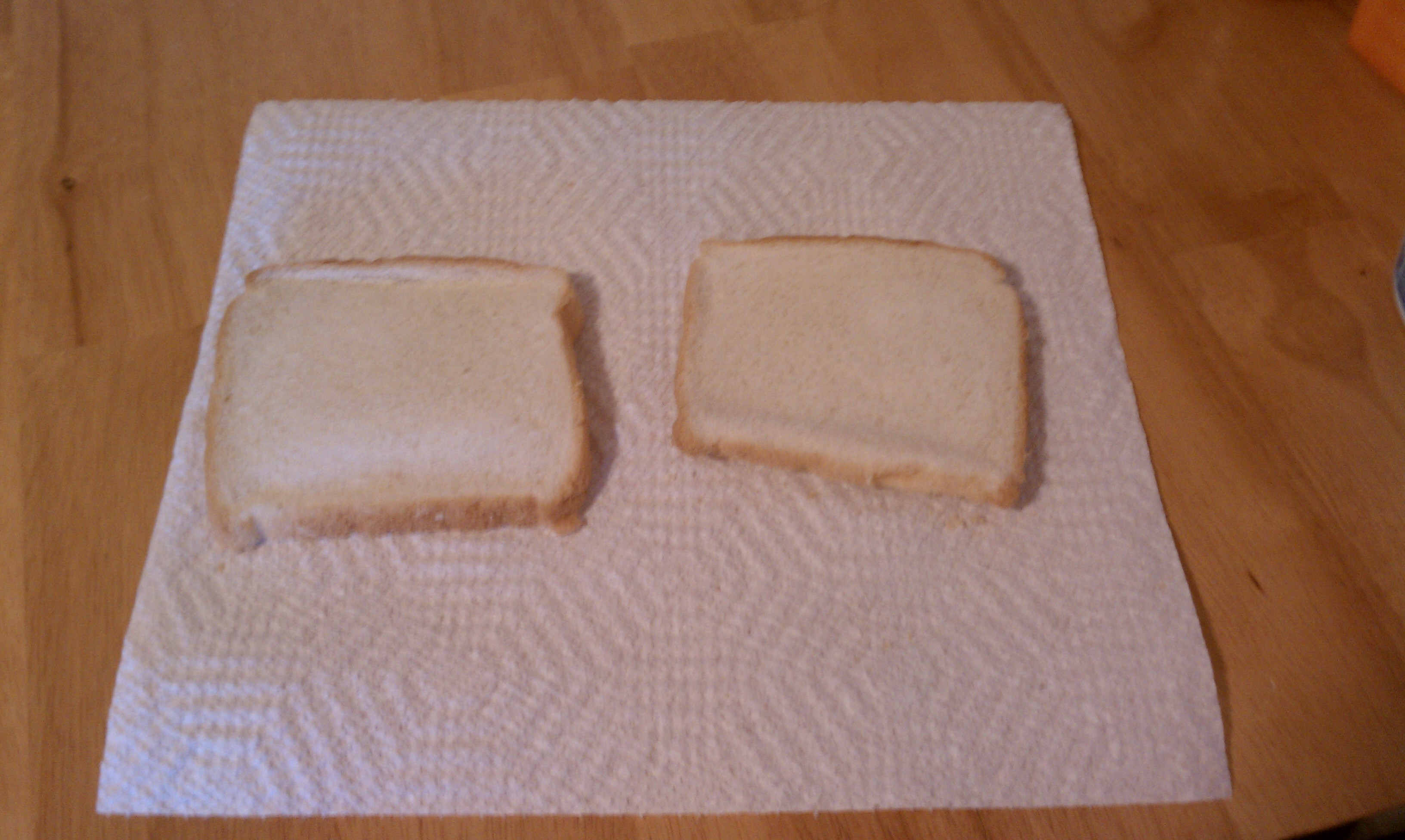 Picture of Place Two Pieces of Bread on a Flat Surface.