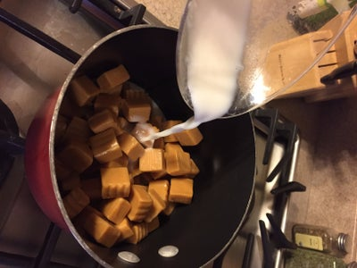 Add Caramel and a Small Amount of Milk Into a Small Pot