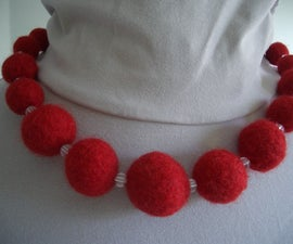 Felt balls from knitting wool for a chunky bead necklace