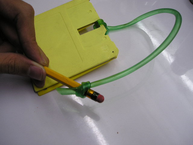 Picture of Tie the Other End of the Hose to the Pencil