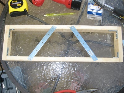 Place L Brackets, Pipe Hanger, and Switch Hole