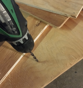 Picture of Drilling Holes in Bottom of Board for Drainage