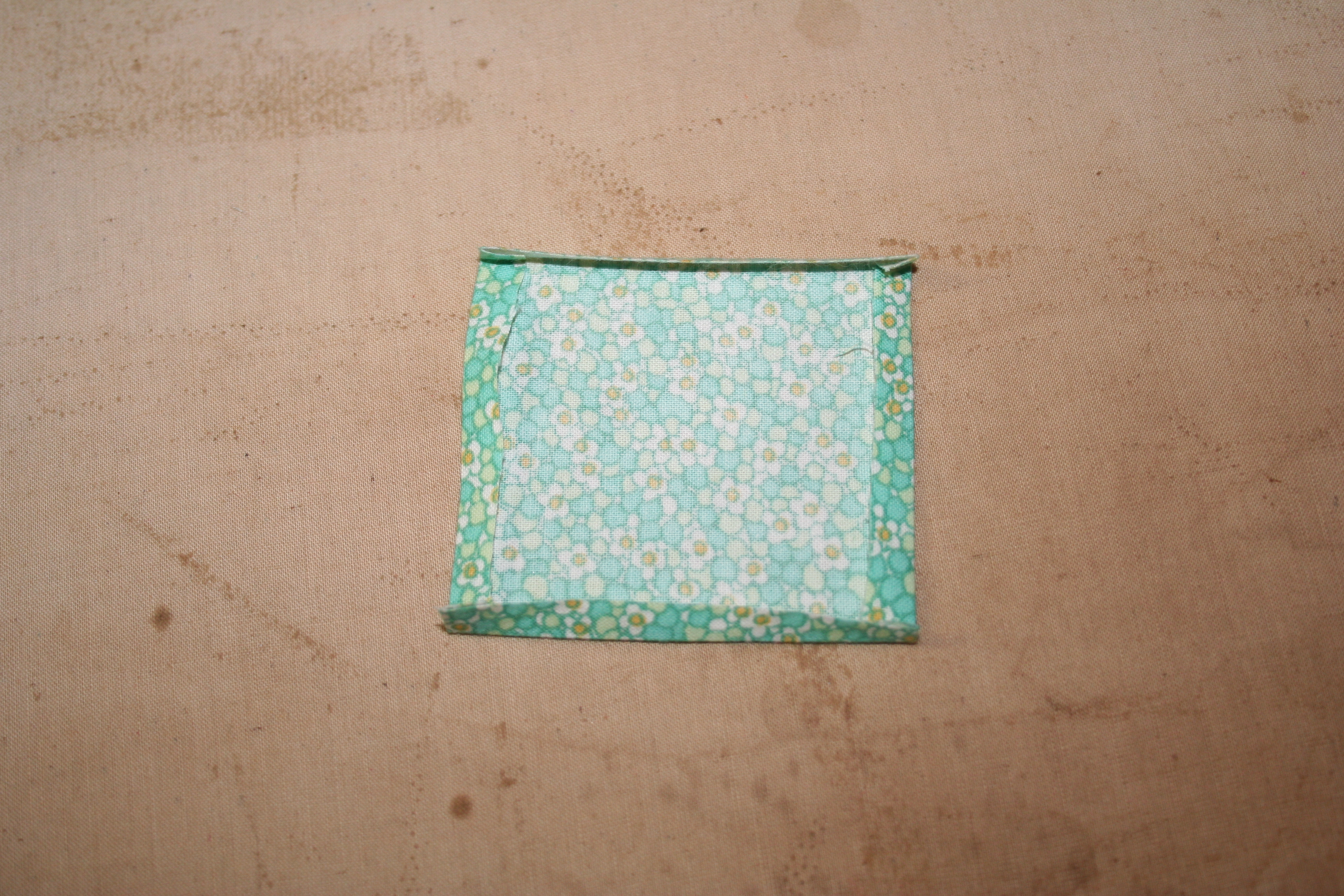 Picture of Cut Squares of Your Fabric & Apply Adhesive