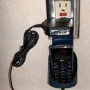 Outlet-mount device charging pocket