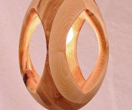 Lumitourni lamp. Sculptural (and dangerous) wood turning by Samuel Bernier