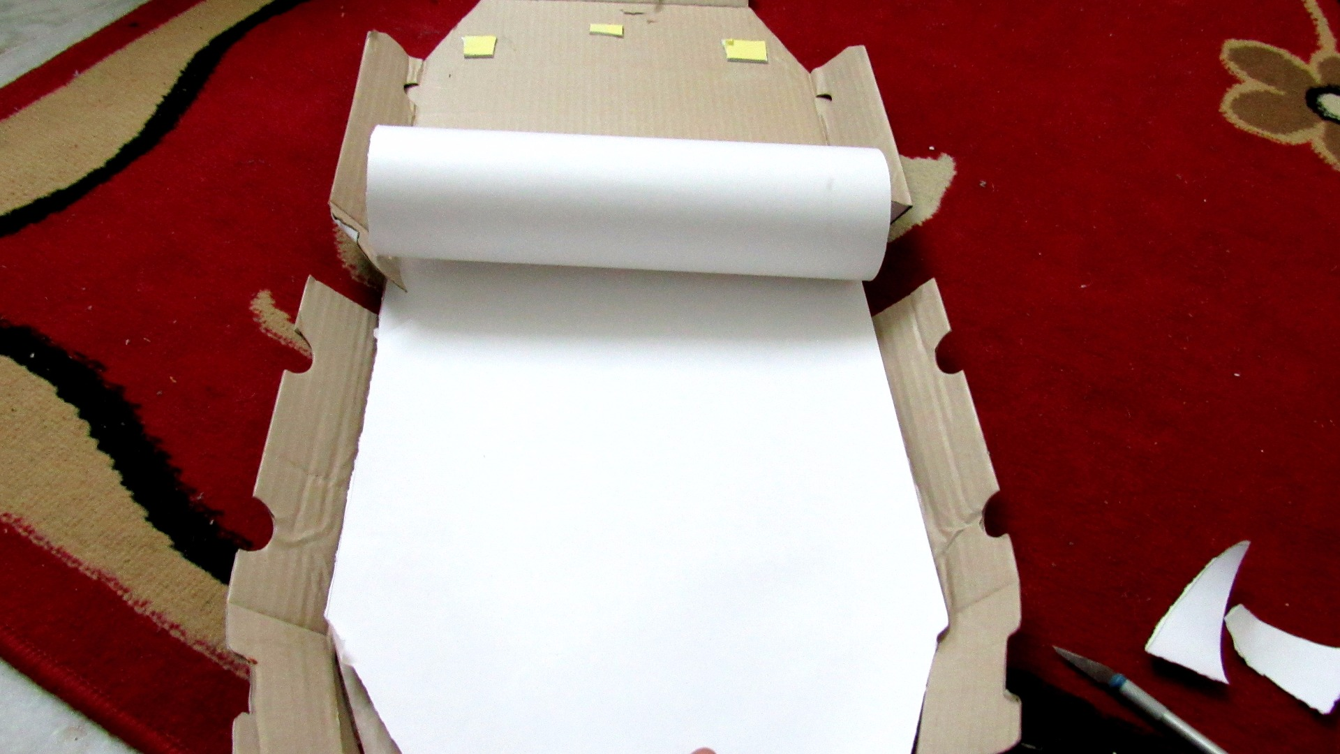 Picture of Putting the Paper on to the Box