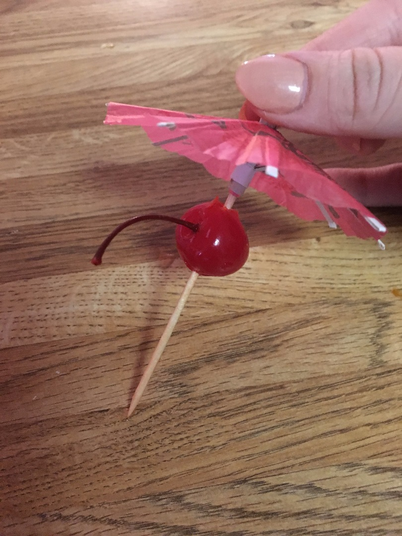 Picture of Take One Umbrella Toothpick and One Maraschino Cherry
