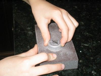 PREPARING THE PLASTIC SODA CAP:
