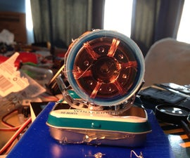 Micro Hadron Collider: A Miniature Model Particle Accelerator Made From Trash