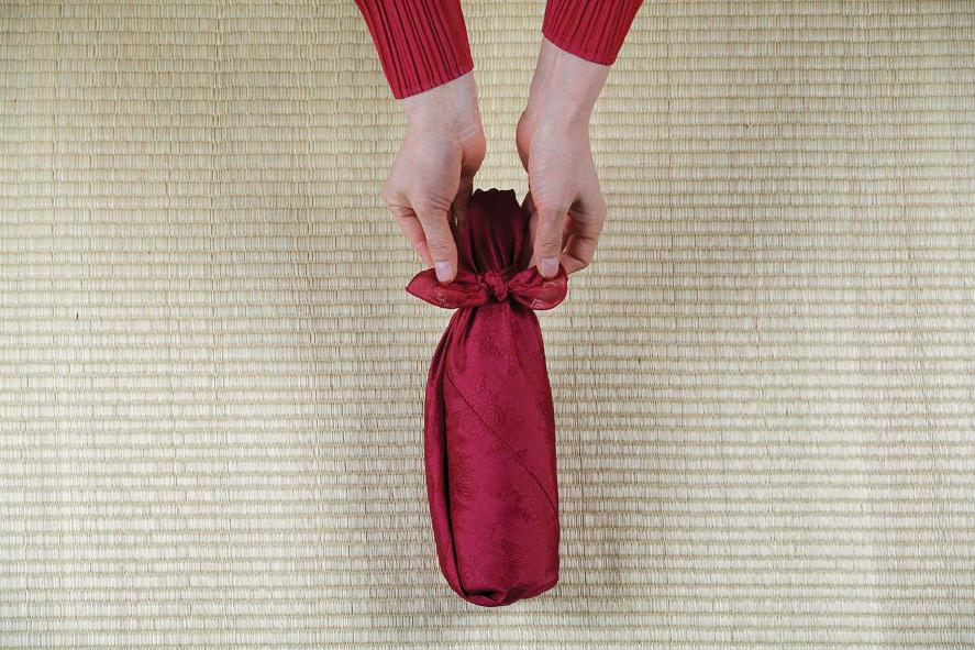 Picture of  Tie Two Knots, Then Use Your Hands to  Achieve a Clean Shape.