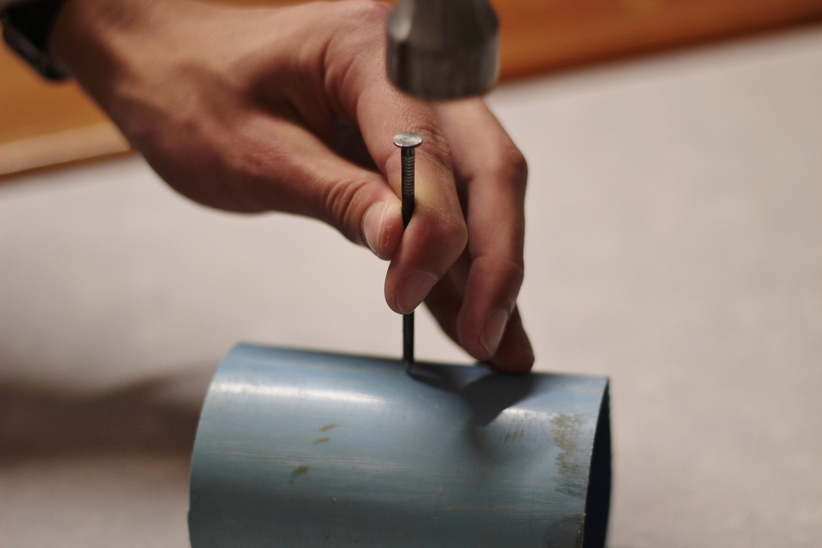 Picture of Hammer the Nail Into the Pipe.
