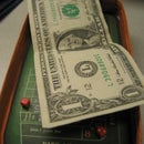 Make a tiny craps table out of stuff around the office.