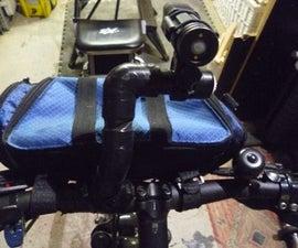 Bike handle bar camera/light holder