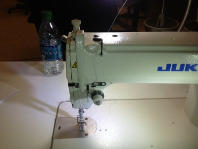 Load the Bobbin and Thread the Sewing Machine.