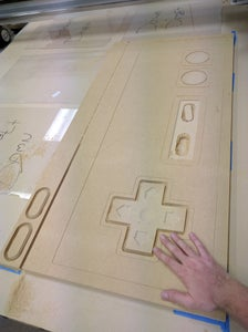 Cut Out the NES Controller and Buttons on the CNC Table Router.