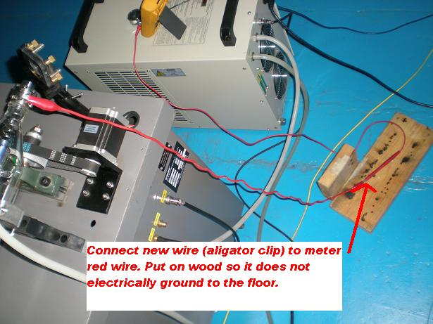Picture of F. Connect Your New Wire to Meter Red Wire. Use an Electrical Insulator, Like the Wood Block Shown, to Support the Wire at the Connection.