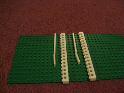 Get Two 1x16 Bricks With Holes in Them and Put Tiles Over 11 Studs on Each Brick.