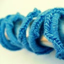 Blue Waves: Crochet-wrapped Earbuds