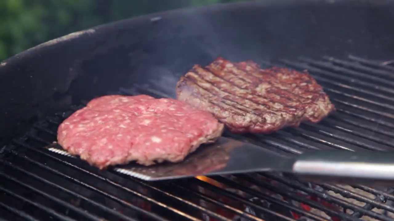 Picture of Once the BBQ Is Nice and Hot Place Your Burgers on the Grill.