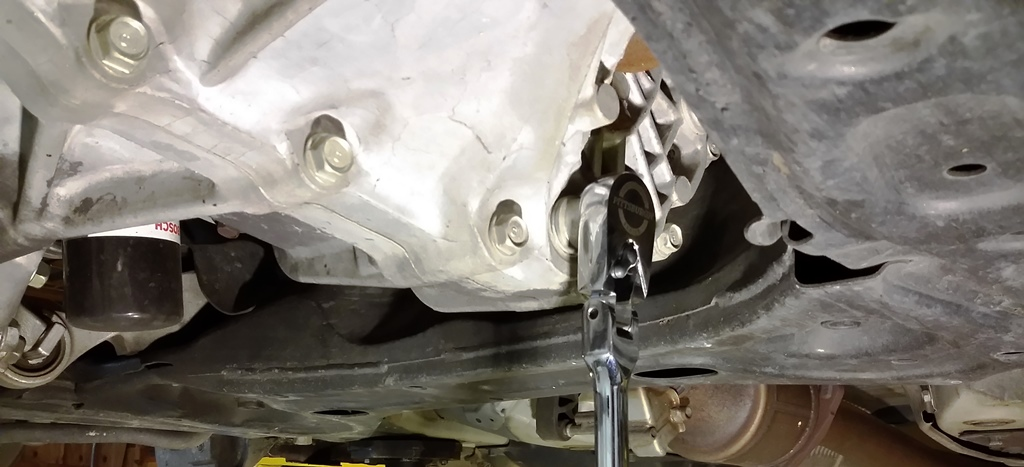 Picture of Drain Transmission, Disconnect Control Arms, and Remove Left Axle