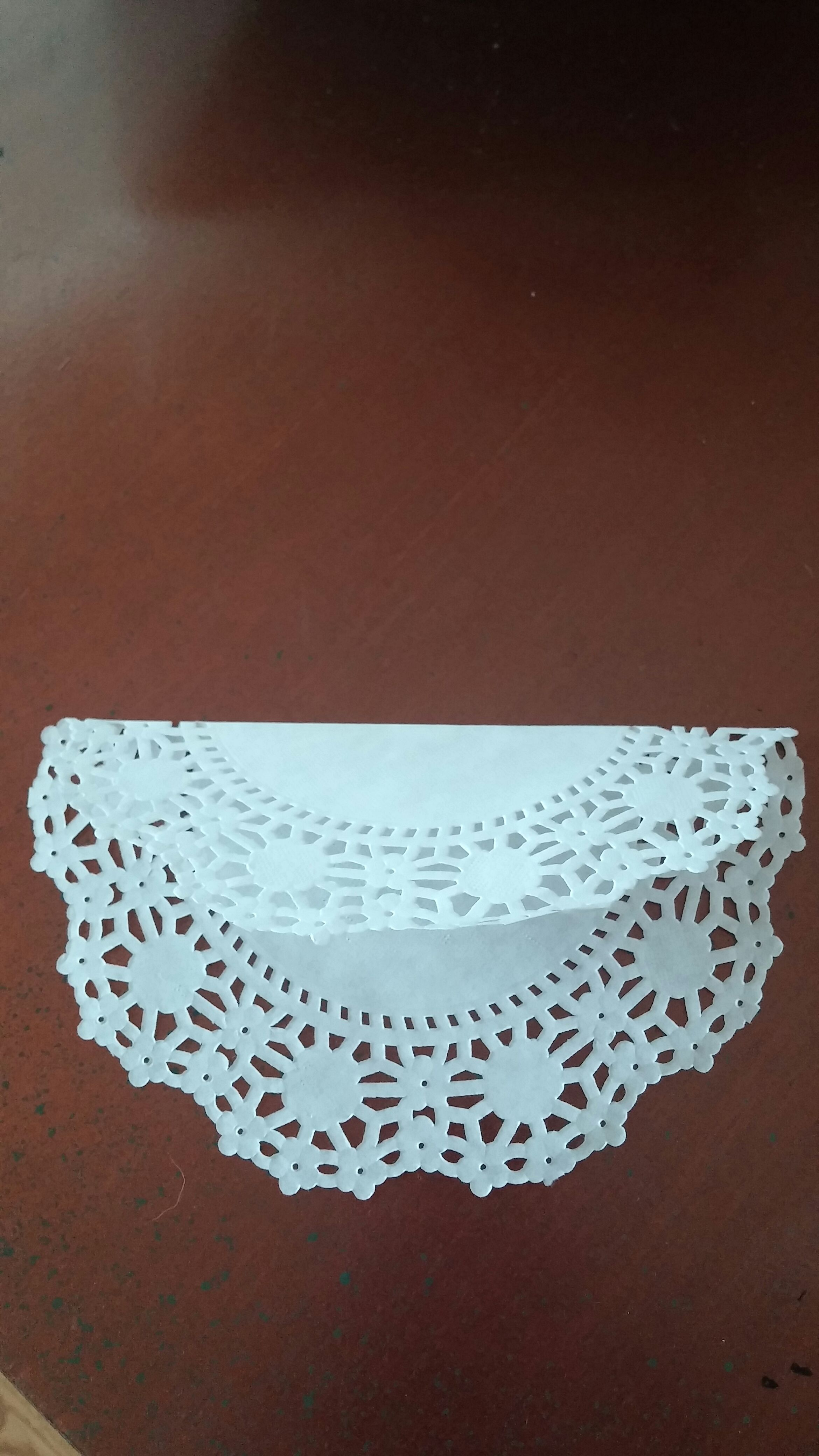 Picture of Folding Doily to Create Dress Bottom