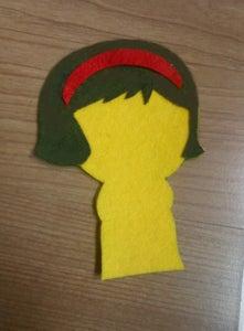 Glue the Red Headband (5) on the Hair.