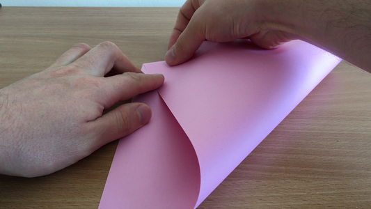 Fold One Side, So That the Corner Meets the Second Corner on the Other Side of the Paper.