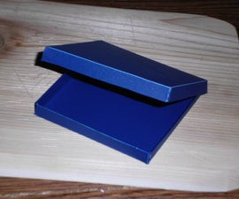 How to Create a Simple Plastic Box Out of an Old Notebook