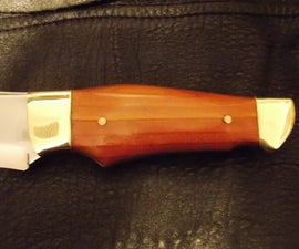 Brass and wooden knife handle