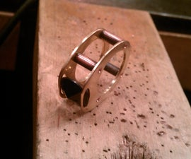 Simple Riveted Stone-trapping Ring