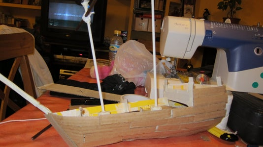 Cover the Boat With Hard Cardboard Pieces