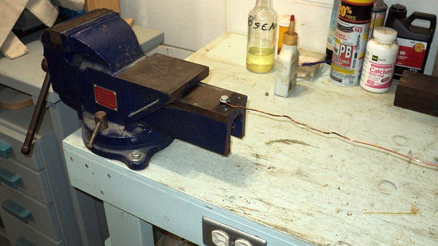 Picture of Using a Bench Vise to Easily Straighten and Strip Wire