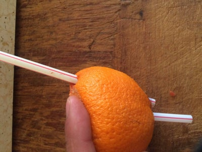 Make a Hole in the Side of the Orange.