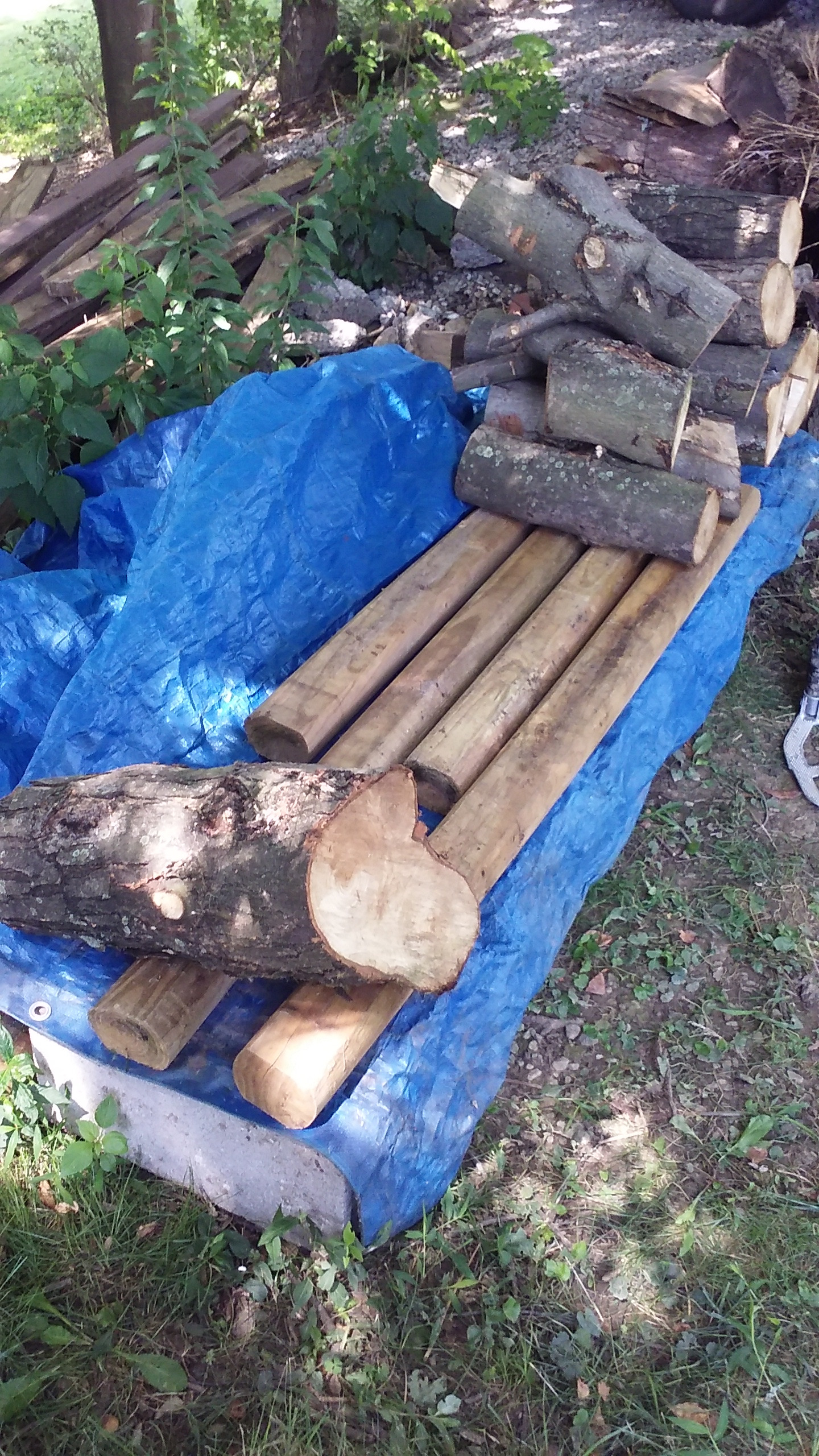 """Picture of Place Heavy """"anchor"""" Firewood Pieces at Each End of the """"shelf""""."""