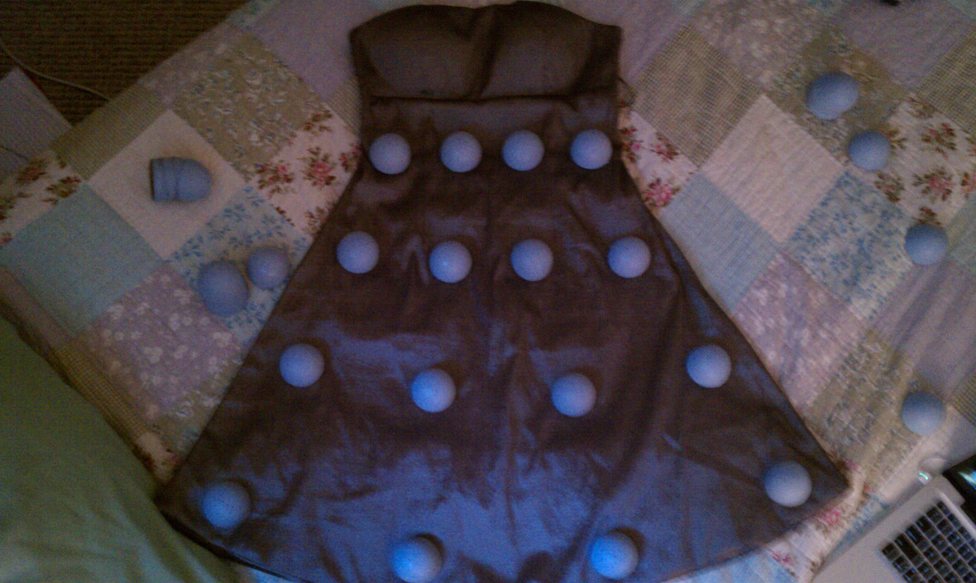 Picture of Sew the Easter Eggs Onto the Dress.