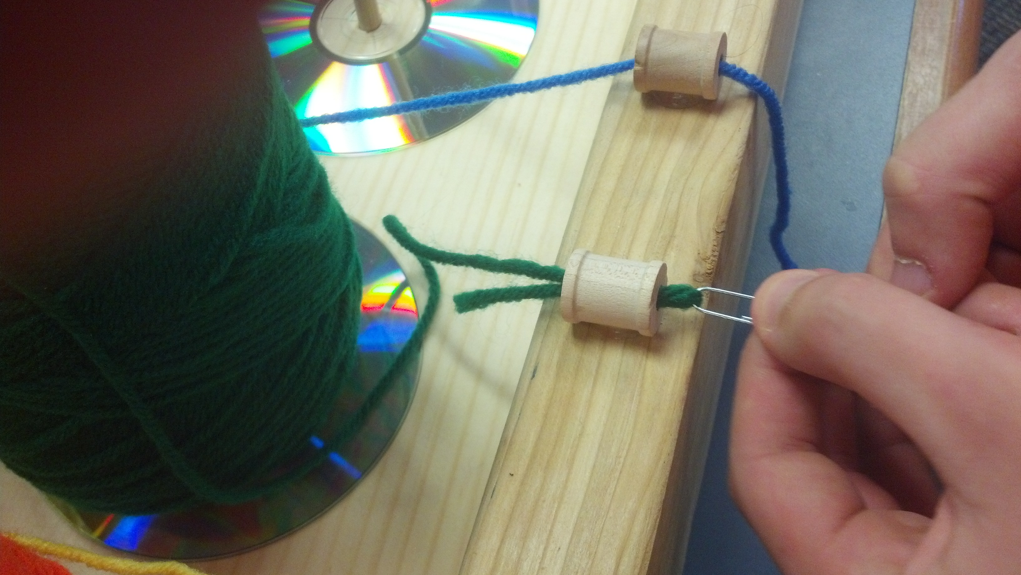 Picture of Add the Yarn Rolls and Thread the Yarn Through the Spools
